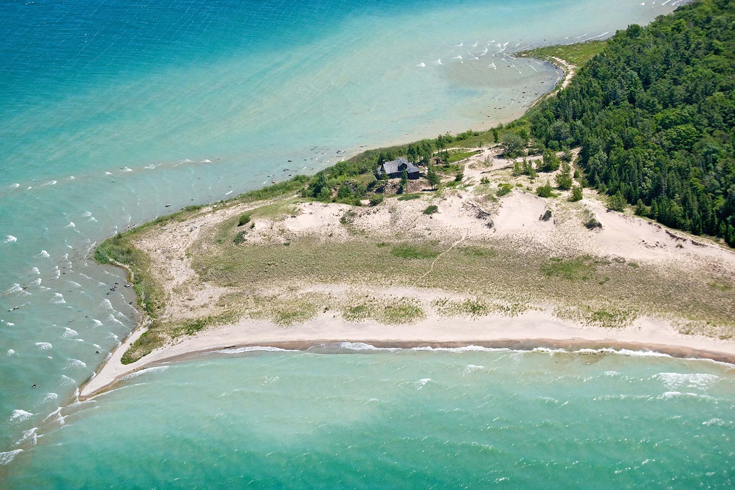 Cathead Point | a case study of how earth asset's due diligence enhances land-based wealth - this 100 acre conserved lake michigan estate owned by melissa's family for 30+ years was sold by earth asset in under 1 year for a record-setting price to a conservation buyer
